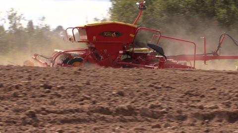 machine spread fertilizer on cultivated field soil in autumn Footage