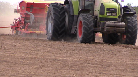 farm tractor with device makes furrow in field Footage