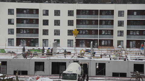 Group of builder workers on flat apartment construction site Footage