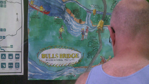 A couple looking at a trail map for Bulls Bridge Recreational Facility (2 of 2) Footage