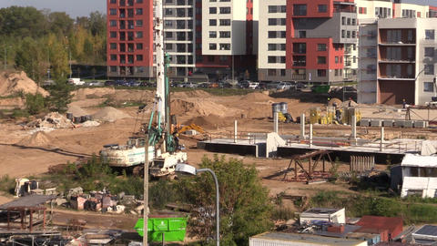 Intensive works in construction site. People work on flat house Footage