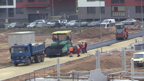 People working on asphalt spread and roller pavement machines Footage
