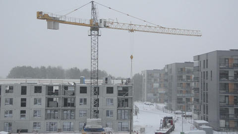 Dramatic snowstorm and construction site workers builders work Footage