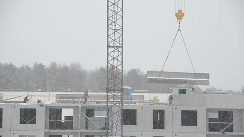 Crane lift concrete house parts and workers on flat house roof Footage