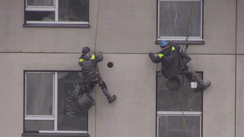 workers with special equipment warming new house wall Live Action