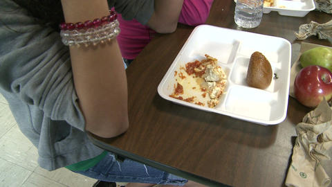 Student eating school bought lunch. (2 of 2) Footage