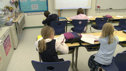 Grammar school students doing work in classroom (3 of 9) Footage
