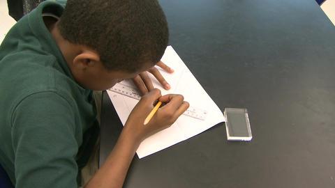 Grammar school students doing work in classroom (9 of 9) Footage
