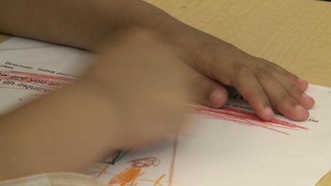 Grammar school child using a crayon (2 of 5) Footage