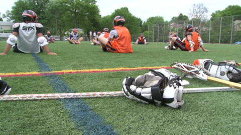 Boys Lacrosse players sitting on the field(3 of Footage