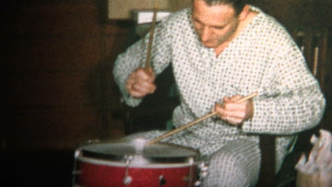 (8mm Vintage) 1965 Dad and Son Playing Drums Together Christmas Morning Footage