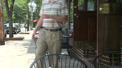 Tables outside a small restaurant Footage