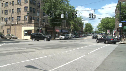 Cars driving through intersection Footage