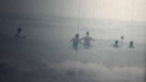 (8mm Vintage) 1966 People On Beach In Ocean Wave Breaks Footage