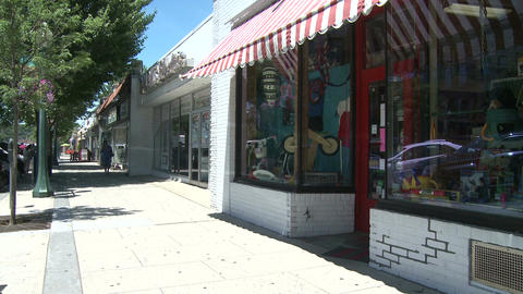 Small store front with a striped awning Footage