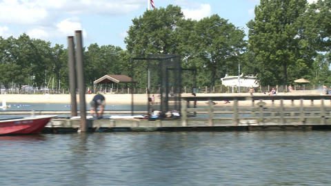 Long Dock With People On A Raft At The End stock footage