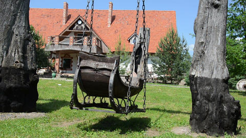 quiet park swings big old wooden sled decorativeness swing Footage