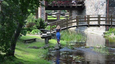 cement edge calm step goes woman leans on edge of bridge Footage