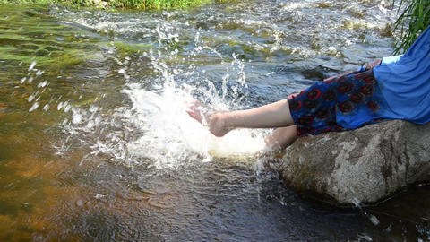 stream bounces off rocks girl with legs caused spray stream Live Action