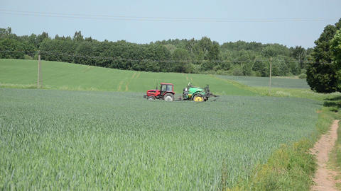 farm tractor with pesticides fertilizing spring crop fields Footage