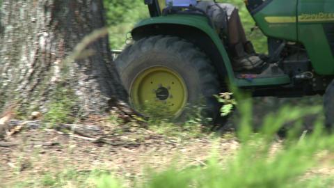 Tractor raking land on vineyard Footage
