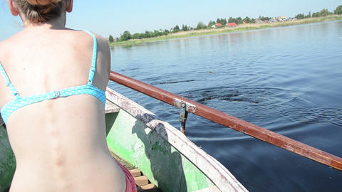 girl rowing boat on your holiday warm summer day Footage