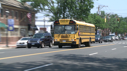 School bus driving through downtown. (1 of 2) Live Action