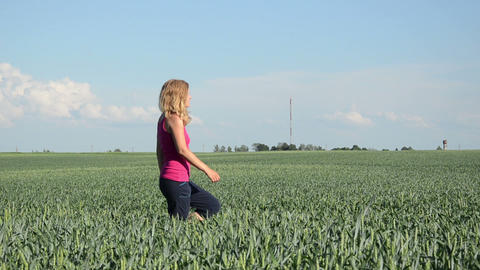 tall blonde woman goes through adult green corn Footage
