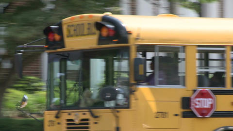 School bus driving through downtown. (2 of 2) Live Action