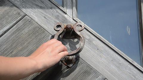 guest hand knock retro rusty door handle used as ringer knocker Footage