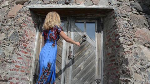 guest woman in dress knock retro rusty door handle Footage