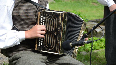 Accordionist young man play folk music with accordion Footage