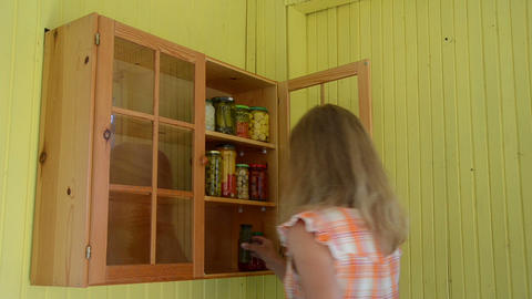 Woman put pot canned pickled food products to storage rack Footage