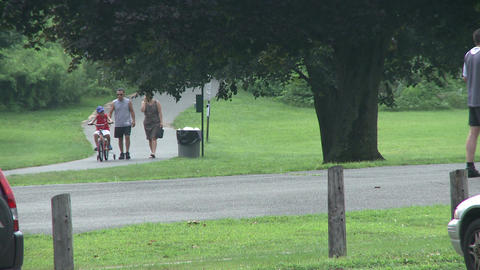 Family walking at a park. (1 of 2) Footage