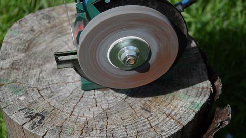 sharpening blade on black electric sharpener Footage