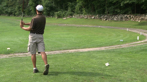 Male golfer teeing off Footage