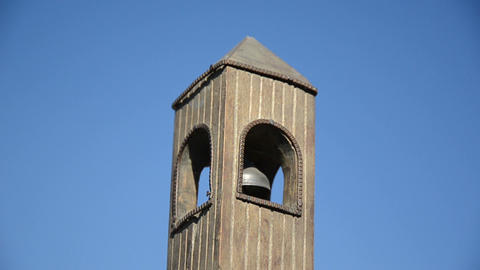 Wooden toy belfry imitation with bell jingle sound on blue sky Footage