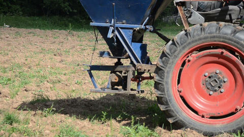 machine tractor wheel and seeder equipment sow buckwheat seeds Footage