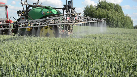 tractor spray chemicals for crop plant protection from weed pest Footage