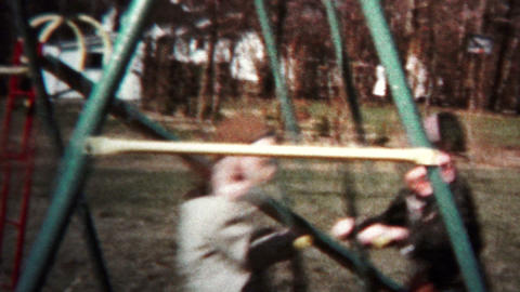 (8mm Vintage) 1957 Kids Playing On Swingset stock footage