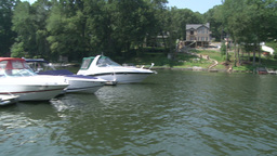 Speed boats docked along the river (1 of 2) Footage