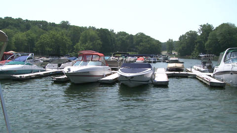 Speed boats docked along the river (2 of 2) Footage