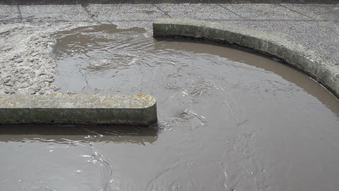 sewage water with scum stream flow in water treatment plant Footage