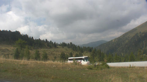 Alpine Road and bus Stock Video Footage