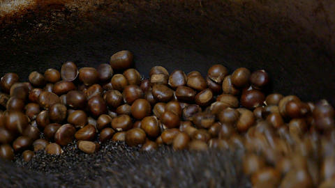 Close Up Of Roast Chestnuts In Chestnut Roasting Machine : 4K Video stock footage