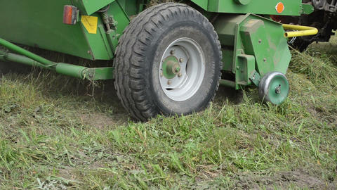 Closeup special machine equipment collect gather hay in field Footage