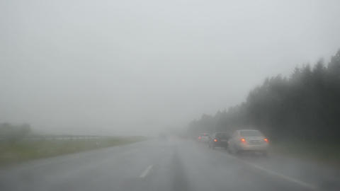 rain falls highway stops cars image through the car glass Footage