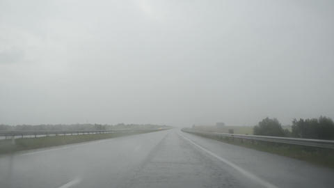 Driving car windscreen view of heavy rain water fall on highway Footage