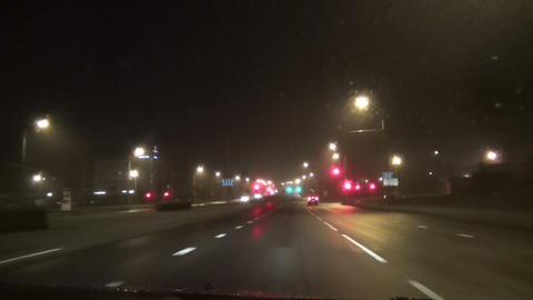 car gets closer to the fog blinking blurry traffic lights Footage