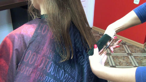 closeup hairdresser woman hands cut client hairs in barber shop Footage